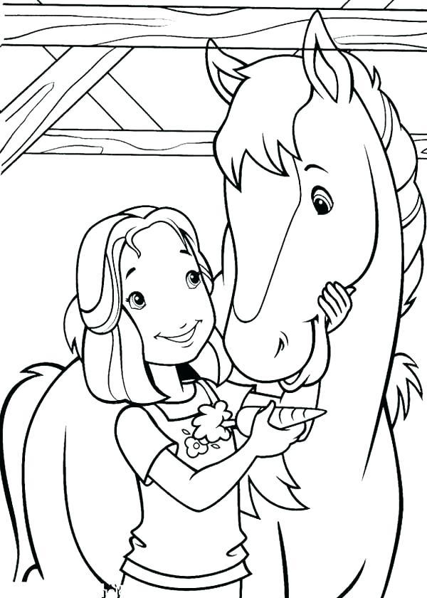 Little Girl Feeding Horse With Carrot
